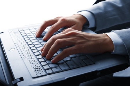 male hands typing on a laptop Stock Photo - 4486988