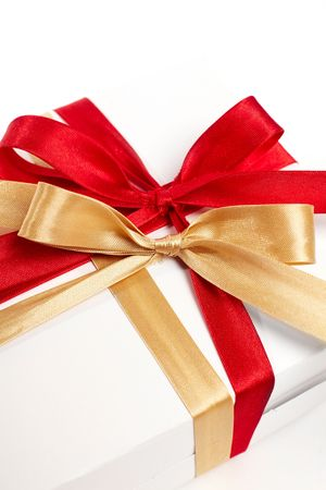 Big red, gold bow on white background photo