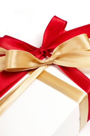 compliment: Big red, gold bow on white background