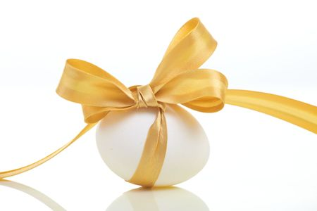Easter egg with a bow photo