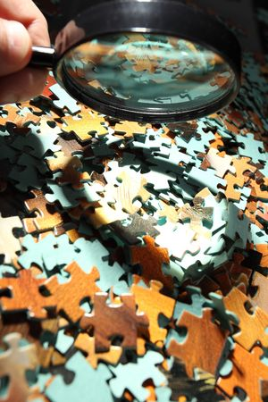 Magnifying glass, puzzle photo