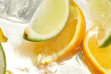 refrigerate: leaf mint and cut citrus in ice   Stock Photo