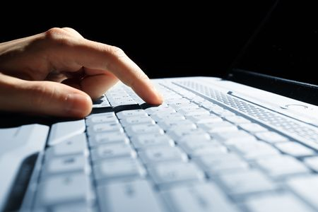 male hands typing on a laptop photo