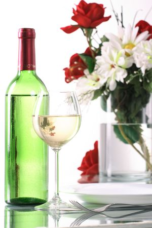 Bottle and glass of wine on the table photo