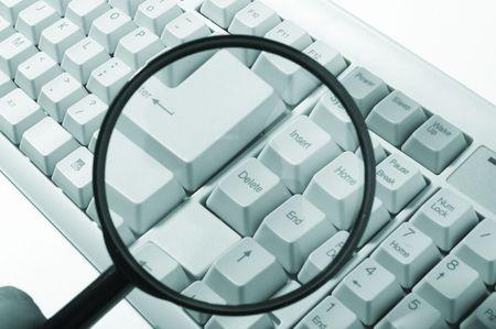 Magnifying glass, button, key Stock Photo - 6819822
