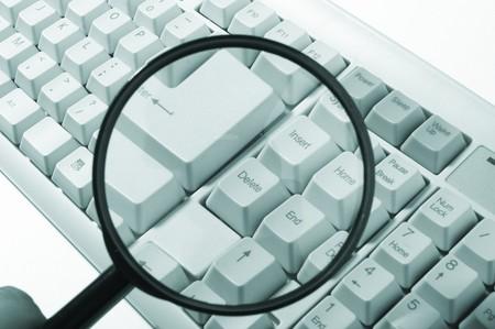 Magnifying glass, button, key Stock Photo - 6929091