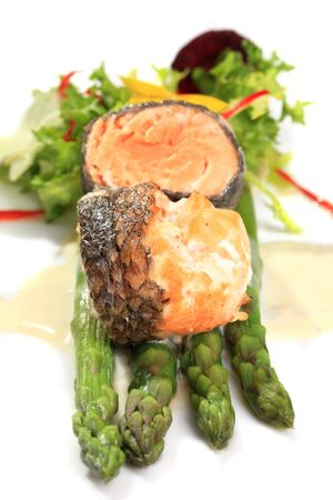 Rosemary roasted salmon served with asparagus photo