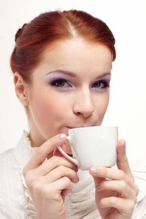Business woman holding cup of coffee. Stock Photo - 7064093