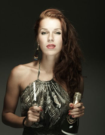 Beautiful woman with bottle of champagne photo