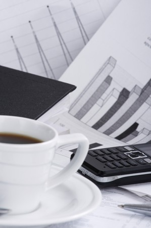 Cup  coffee on a morning paper business news Stock Photo - 7900793