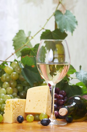 dine: Wine and Cheese still life Stock Photo