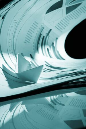 Business concept, paper boat and tsunami documents photo