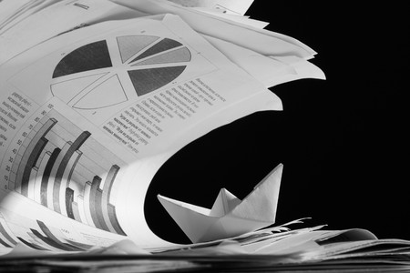 paper boat: Business concept, paper boat and tsunami documents Stock Photo