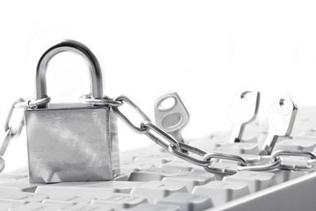 Computer  keyboard secured with chain and padlock Stock Photo - 8163319