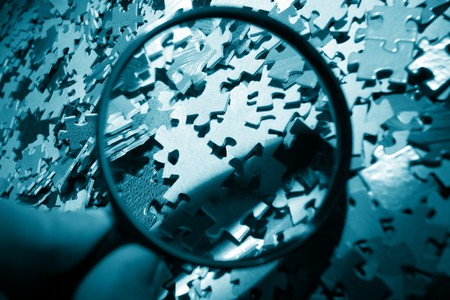 Magnifying glass, puzzle Stock Photo