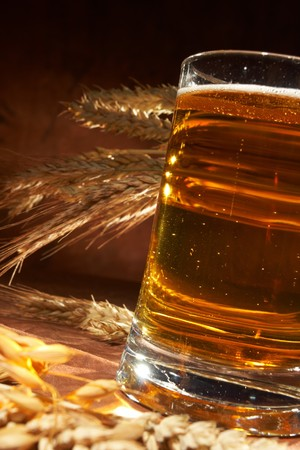 Glass of beer with grain photo