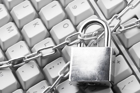 Computer  keyboard secured with chain and padlock Stock Photo - 8221304