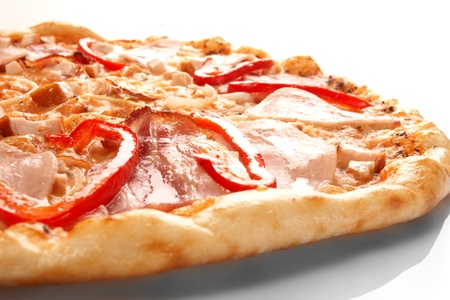 slice tomato: Pizza with pepper and ham Stock Photo