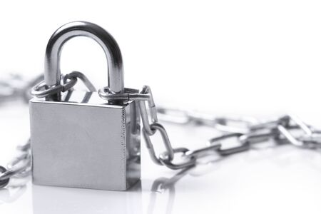 Lock and chain  on the white background photo