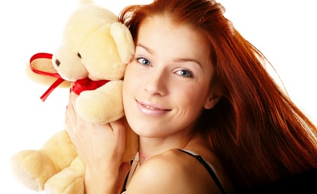 Beautiful woman holding a teddy bear photo