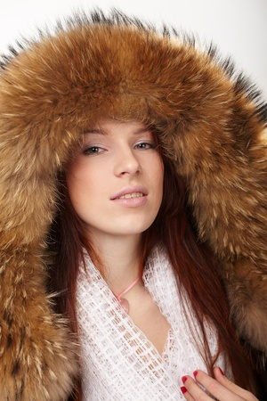 Beautiful woman in winter fur coat photo
