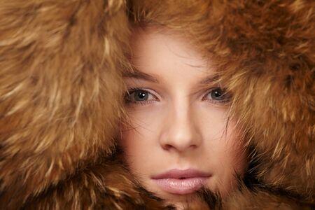 Beautiful woman in winter fur coat photo
