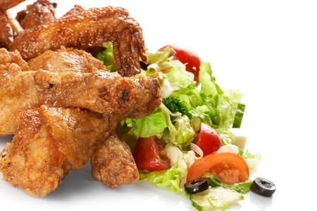 baked chicken: Chicken legs with fresh vegetables Stock Photo