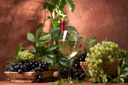 White dry wine, fresh clusters of a grapes photo