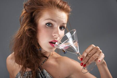 Beautiful woman with a cocktail photo