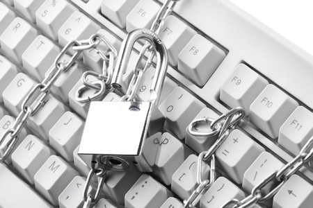 Computer  keyboard secured with chain and padlock   photo