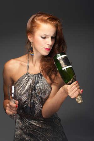 Beautiful woman with champagne photo