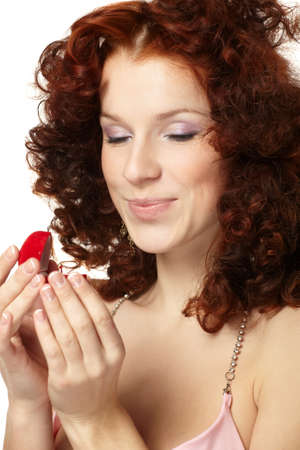 Beautiful  woman with red gift box with jewellery photo