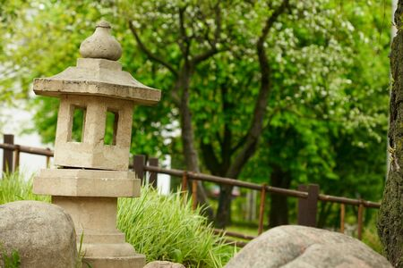 Japanese garden with stone pagoda  photo
