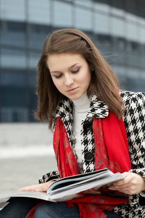 Young woman with magazine photo