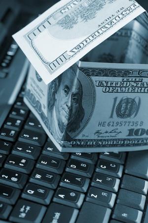 dollars on the keyboard photo