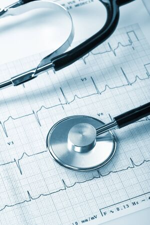 clean lungs: stethoscope on the cardiogram Stock Photo