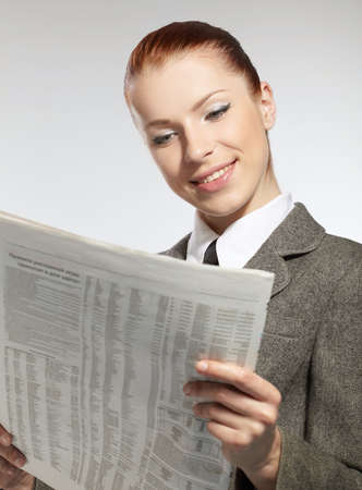 businesswoman with newspaper photo