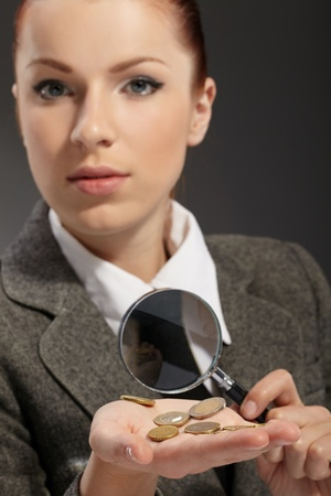 portrait of young businesswoman with magnifying glass photo