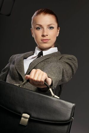 businesswoman with black briefcase photo