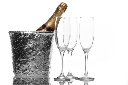 champagne flutes: Champagne flutes and ice bucket