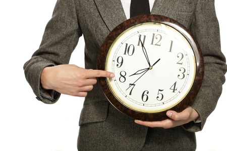 Businesswoman holding clock in hands photo