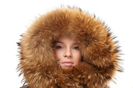 fur hood:   Beautiful woman in winter fur coat Stock Photo