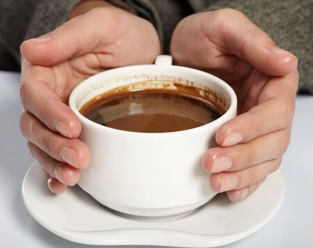 women holding cup: woman�s hands holding a cup of coffee