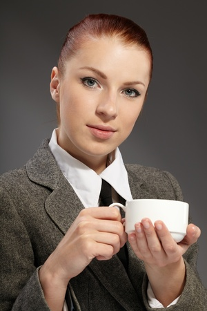 Business woman holding cup of coffee.  photo