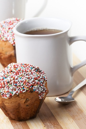 Tasty muffins with cup of tea photo