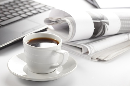 business news: Cup of fragrant coffee on a morning paper business news