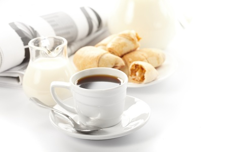 Cup of fragrant coffee on a morning paper business news Stock Photo - 9558747