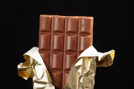chocolate in bar with open gold cover.  Stock Photo - 9602010