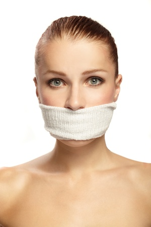 Cute young woman with white band on the mouth Stock Photo - 9599365