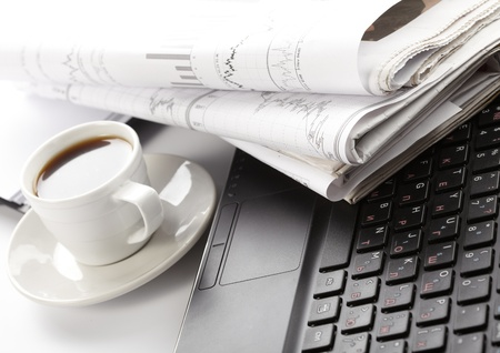 read news: Cup of fragrant coffee on a morning paper business news